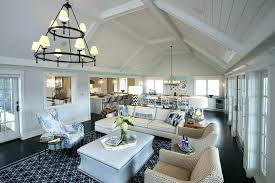 family room chandeliers great room layout living room beach style with black floors transitional table lamps