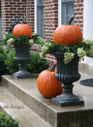 Simple way to decorate the front of your home using your urns ...