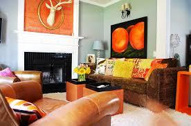 ... Eclectic living room in orange and black [Design: Judith Balis  Interiors]