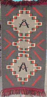 this unusual navajo rug is not very old and depicts two masonic square and compasses with the letter g it appears to contain germantown yarn with fringe