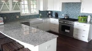 white countertop backsplash colonial white granite mosaic glass tile eclectic kitchen backsplash with white corian countertops white cabinets grey