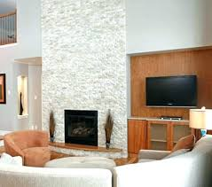white stone fireplace living room with decor whit
