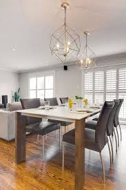 modern dining room design with silver caged hanging light fixtures hibou design co hanging light fixtureshanging lampskitchen