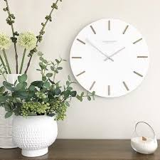 london clock company hvit white wall