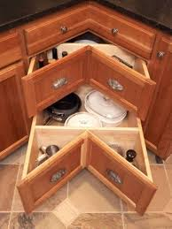 an angled drawer may be better than a spinner corners are so deep and this
