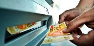 Resultado de imagem para dinheiro no caixa fotos
