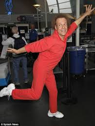 richard simmons sweat band. natural performer: richard simmons took the strict airport security measures in stride by performing a sweat band e