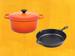enameled cast iron and cast iron skillet on yellow background