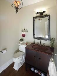 half bathrooms. Half Bath With Elegant Mirror And Light Fixtures Bathrooms O