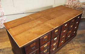 20th century vintage wooden counter multi drawer apothecary storage cabinet for