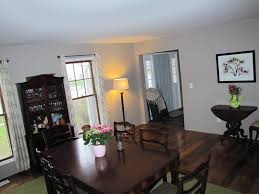 dining room with 7 piece wooden dining set and display cabinet also accent table on brazilian teak hardwood floor by lumber liquidators