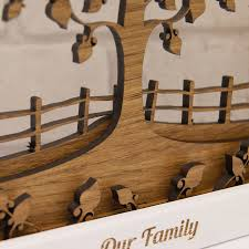 wooden layered family tree in natural oak on wall art wooden tree with personalised wooden 3d layered family tree wall art by urban twist