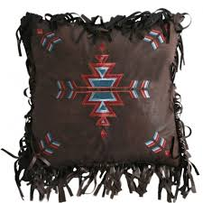 turquoise chamarro embroidered cross pillow carstens