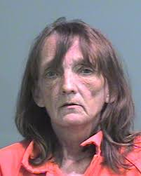 Woman arraigned on charge that she stabbed husband with butcher ...