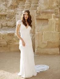 moroccan wedding dress. Picture Of boho Moroccan wedding dress with a V neck lace cap
