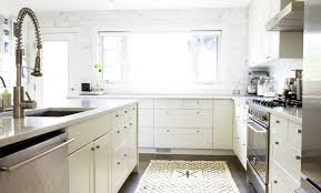 moth design amazing kitchen with ikea kitchen cabinets paired with hanstone quartz countertops and ceiling height marble subway tile backsplash