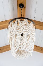 white chandelier pottery barn edit pertaining to popular household wood bead chandelier pottery barn prepare