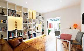 living area with bookshelves open plan extension