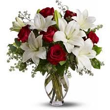 picture of exquisite flower bouquet with red roses white oriental lilies and greenery