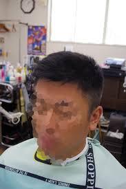 髪型残っているアイロンパーマとフェードカットメンズカット