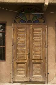 go to previous picture picture of old wooden door with coloured window on top