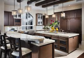 Kitchen With Bianco Romano Granite Countertop And Brown Cabinets