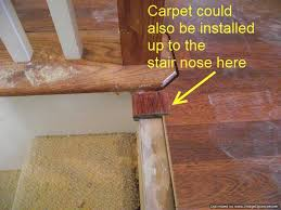the laminate is installed up to the stair nose on the top stair