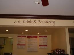 a wall decor on the overhead beam in the cafe area eat drink