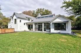 pole barn house plans black windows board and batten siding covered patio grass gravel metal roof afford