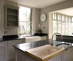 Lovely monochromatic European kitchen design with gray kitchen cabinets,  gray walls paint color, Ubatuba