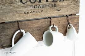 Hanging white coffee mugs from rusty S hooks on a coffee station sign /  FunkyJunkInteriors.