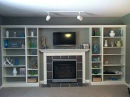 Living Room Shelf White Stained Wood Built In Book Cabinet With Open Shelf Around Fireplace And Tv Stand Combined Grey Painted Wall And Grey Carpetjpg