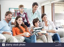 black family watching tv. extended family watching tv together black tv