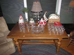 one of the many tables with a few items and glassware