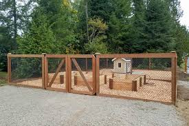 ajb landscaping fence built this unique outdoor dog kennel that doubles as a raised garden