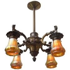 four arm edwardian bronze chandelier with period steuben glass shades for