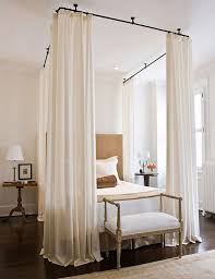 For a modern take a on the traditional canopy bed, try bed curtains.  Instead of being mounted on a canopy bed, these curtains look great hung  from the ...