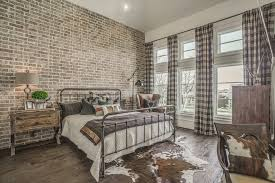 faux cowhide rug and plaid curtains are also perfect things to add in rustic interiors