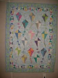 Fly a kite quilt (someday when I'm better with triangles ... & KITE QUILT have different people make them Adamdwight.com