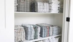 organized linen closet by a professional organizer