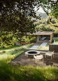 the concrete and steel fire pit is landscape architect bernard trainor s design creating an outdoor