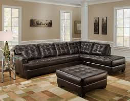 dark brown leather tufted sectional chaise lounge sofa with ott furniture table living room laminate wood flooring tiles plus light and white wall interior