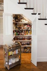 I love the idea of the pantry tucked up under the stair case. Lots of extra  storage space. Shawna's Glamorous Custom Kitchen The walk in pantry is  tucked ...