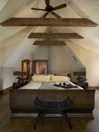 rustic attic with captivating rustic attic bedroom ideas with dark gold bed frame and black wooden stool furnished dark electric fan without lamp