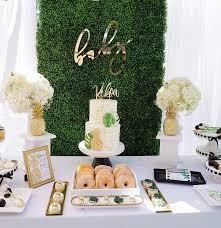 elegant tropical baby shower theme with golden details and fun treats