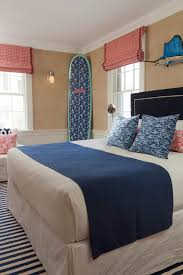inspiration for a beach style light wood floor bedroom remodel in boston with beige walls