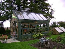 grow food all year long recycled patio door greenhouse project good ideas cinder block floor over hardware cloth prevents rodents digging in and under