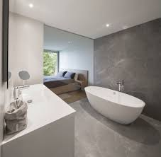 tile flooring bedroom. Another Bedroom With White Walls And Recessed Lights Features A Personal Soaking Tub On The Side.MU Architecture Tile Flooring D