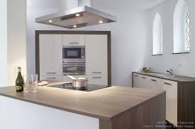 historic modern wood furniture. Minimalist Kitchen With Cream Cabinets And Walnut Wood Countertops Complements The Gothic Arches Of This Historic Modern Furniture