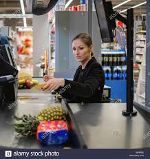 Woman Cashier Working In A Grocery Store Stock Photo